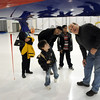 Marcela Toledo, left, her son Said Cisneros, 7, from Boulder, with Sreeni Anumala and his son Nithin, 9, from Emerald Elementary School in Broomfield, look as Jose Meitin, NCAR project manager, explains the sensors on the NCAR Gulfstream V aircraft which is being outfitted for the HIPPO II reasearch project at the NCAR base at Rocky Mountain Metro Airport on Wednesay.<br /> <br /> October 21, 2009<br /> Staff photo/David R. Jennings