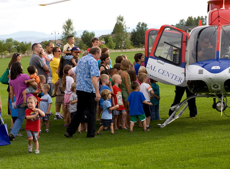 Kids and parents check out the Med-Evac helicopter after a landing at the Broomfield County Commons on Tuesday evening during the National Night Out. Photo by Matt Kelley/For the Enterprise