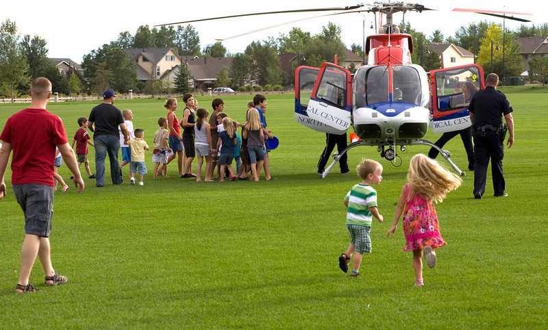 Kids run to check out the Med-Evac helicopter after a landing at the Broomfield County Commons on Tuesday evening during the National Night Out. Photo by Matt Kelley/For the Enterprise