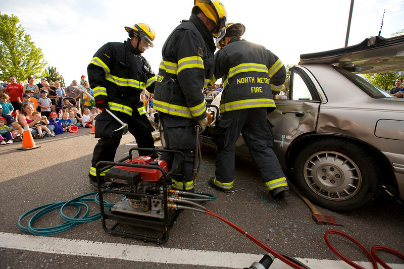 Firefighters from the North Metro Fire Department demonstrate freeing a victim from a car using the 'Jaws of Life' at the Broomfield County Commons on Tuesday evening during the National Night Out. Photo by Matt Kelley/For the enterprise