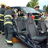 North Metro Fire firefighters remove the top of a car during an extrication demonstration for National Night Out at the Broomfield County Commons on Tuesday.<br /> <br /> August 2, 2011<br /> staff photo/ David R. Jennings