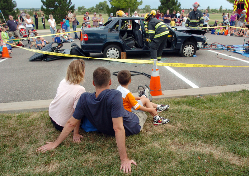National Night Out attendees watch North Metro Fire firefighters demonstrate a car extrication at the Broomfield County Commons on Tuesday.<br /> <br /> August 2, 2011<br /> staff photo/ David R. Jennings