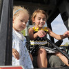 Payton Delier, 6, right, and her sister Taylor, 3, play with the controls of a backhoe during National Night Out at the Broomfield County Commons on Tuesday.<br /> <br /> August 2, 2011<br /> staff photo/ David R. Jennings