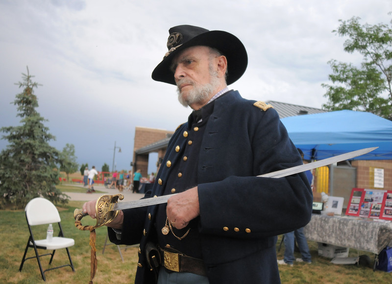 Bob Moulder dressed as a Civil War officer for the Broomfield Veterans Memorial Museum exhibit during National Night Out at the Broomfield County Commons on Tuesday.<br /> <br /> August 2, 2011<br /> staff photo/ David R. Jennings