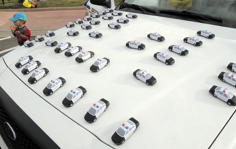 Toy police cars sit on the hood of a police car during National Night Out at the Broomfield County Commons on Tuesday.<br /> <br /> August 2, 2011<br /> staff photo/ David R. Jennings