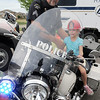 Broomfield Police Sgt. Rick Kempsell watches Kathleen Brening, 5, sit on his motorcycle during National Night Out at the Broomfield County Commons on Tuesday.<br /> <br /> <br /> August 2, 2011<br /> staff photo/ David R. Jennings