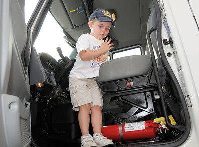 Dylan Evelsizer, 4, looks down from the cab of a large city and county truck during National Night Out at the Broomfield County Commons on Tuesday.  August 2, 2011 staff photo/ David R. Jennings