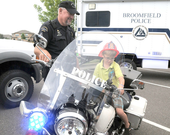Broomfield Police Sgt. Rick Kempsell lets Connor Brening, 5, sit on his motorcycle during National Night Out at the Broomfield County Commons on Tuesday.<br /> <br /> August 2, 2011<br /> staff photo/ David R. Jennings