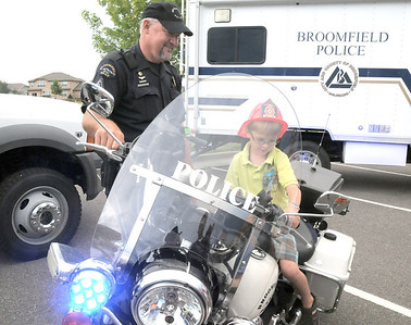 Broomfield Police Sgt. Rick Kempsell lets Connor Brening, 5, sit on his motorcycle during National Night Out at the Broomfield County Commons on Tuesday.  August 2, 2011 staff photo/ David R. Jennings