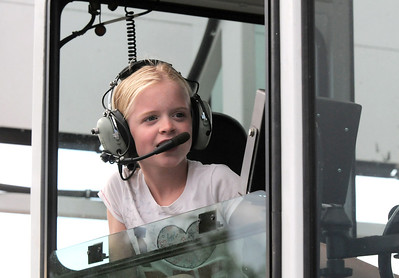 Kelly Myers, 10, talks on the radio to the front cab of the road stripe painting truck during National Night Out at the Broomfield County Commons on Tuesday.  August 2, 2011 staff photo/ David R. Jennings