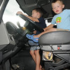 Tyler Longwell, 4, left, and his brother Joshua, 2, try their hands at the wheel of a truck during National Night Out at County Commons Park on Tuesday.<br /> <br /> <br /> August 4, 2009<br /> staff photo/David R. Jennings