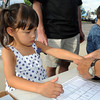 Catalina Hiller, 4 1/2, gets her fingers printed during National Night Out at County Commons Park on Tuesday.<br /> <br /> <br /> August 4, 2009<br /> staff photo/David R. Jennings