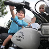 Brady Monzingo, 3, sits on a Broomfield Police motorcycle during National Night Out at County Commons Park on Tuesday.<br /> <br /> <br /> August 4, 2009<br /> staff photo/David R. Jennings