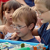Jason Arbuckle, 5, left, and his brother Hathan, 8, watch the storm water demonstration during National Night Out at County Commons Park on Tuesday.<br /> <br /> <br /> August 4, 2009<br /> staff photo/David R. Jennings