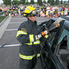 North Metro Fire Rescue firefighter Eric Young cuts part of the roof of a car for an extrication demonstration during National Night Out at County Commons Park on Tuesday.<br /> <br /> <br /> August 4, 2009<br /> staff photo/David R. Jennings