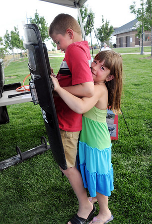 Parker Boltz, 9, gets help from his sister Skyler Boltz, 6, on handling a SWAT sheild during National Night Out at County Commons Park on Tuesday.<br /> <br /> <br /> August 4, 2009<br /> staff photo/David R. Jennings