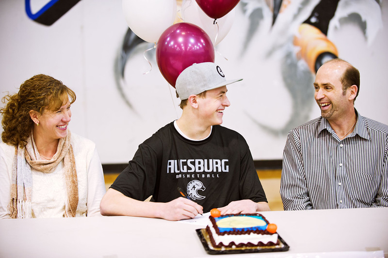 S0202BROOMFIELD8.jpg S0202BROOMFIELD8<br /> Broomfield's Brandon Little has a laugh with his parents, Bob Little and Jennifer Little while Colton signs his letter of intent to Augsburg College during the signing ceremony held at Broomfield High School on Wednesday afternoon, February 1st, 2012.<br /> <br /> Photo by: Jonathan Castner