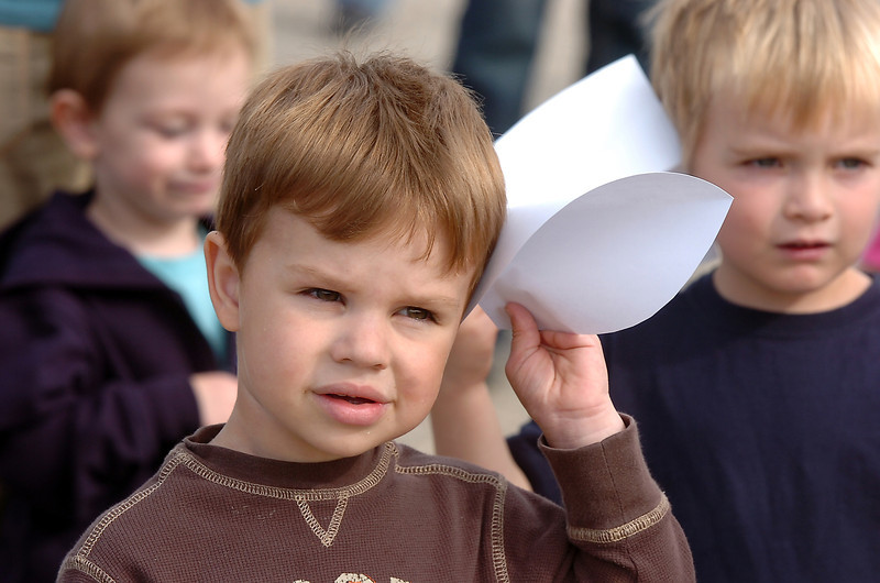 Ben Sievers, 3, uses a piece of paper to help demonstrate a coyote's hearing during the Broomfield Nature Program at Josh's Pond on Wednesday.<br /> October 5, 2011<br /> staff photo/ David R. Jennings