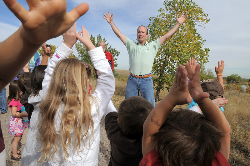 Broomfield wildlife master Chris Petrizzo teaches preschoolers how to look big to coyotes during the Broomfield Nature Program at Josh's Pond on Wednesday.<br /> October 5, 2011<br /> staff photo/ David R. Jennings