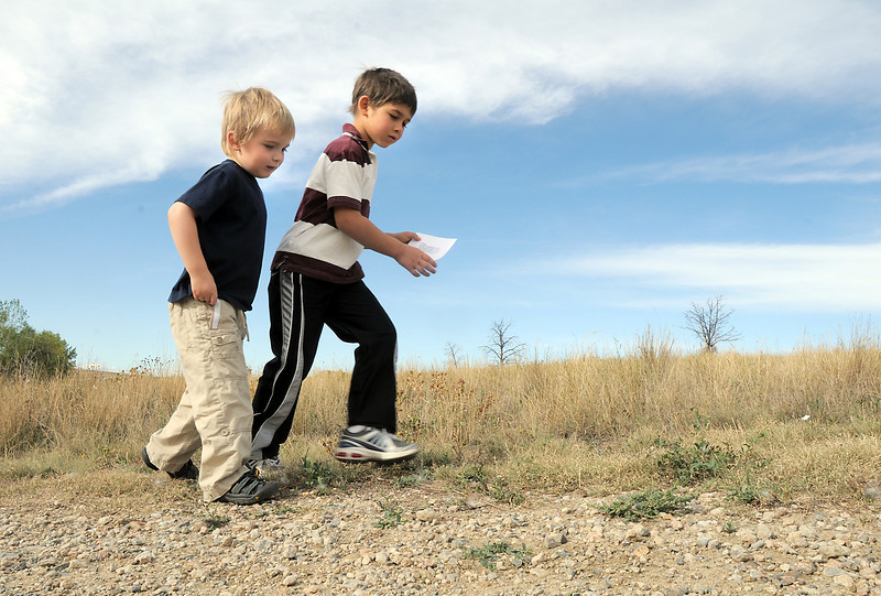 Henry Thompson, 4, left, and Luke Sarris, 5, search for more photographs of coyotes during the Broomfield Nature Program at Josh's Pond on Wednesday.<br /> October 5, 2011<br /> staff photo/ David R. Jennings