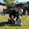 "Jim O'Dell installs a head stone in the front yard of his home, on Thursday, which he will turn in to the ""Chilling Hour"" haunted house at 920 Coral St. for Halloween.<br /> <br /> October 22, 2009<br /> Staff photo/David R. Jennings"