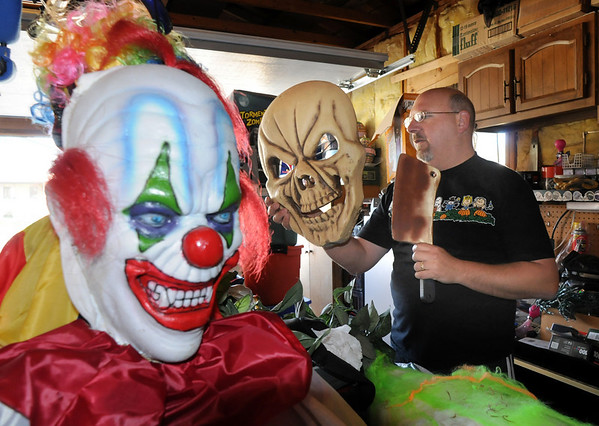 "Jim O'Dell sorts through items for his ""Chilling Hour"" haunted house at 920 Coral St. on Thursday for Halloween.<br /> <br /> October 22, 2009<br /> Staff photo/David R. Jennings"