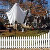 "A ""ghost"" rises above the white picket fence to haunt 1385 Abiline Dr., on Thursday, decorated for Halloween.<br /> <br /> October 22, 2009<br /> Staff photo/David R. Jennings"