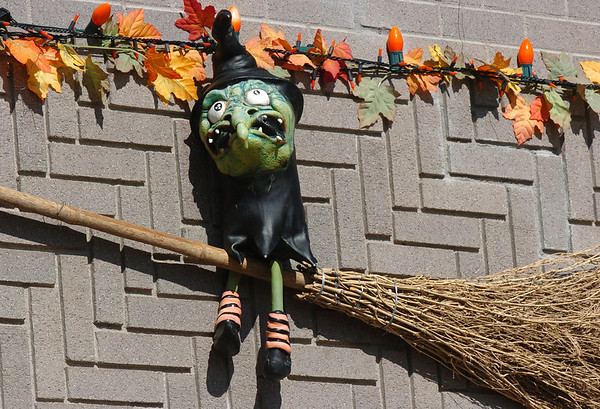 A little witch on a broom is part of the Halloween decorations at 13941 Tincup Circle.<br /> <br /> October 22, 2009<br /> Staff photo/David R. Jennings