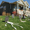 Skeletons and headstones create a Halloween cemetery at 13738 Star Creek Dr. on Thursday.<br /> <br /> October 22, 2009<br /> Staff photo/David R. Jennings