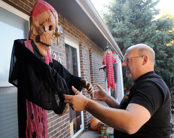 "Jim O'Dell, on Thursday, arranges a pirate skeleton for his ""Chilling Hour"" haunted house at 920 Coral St. for Halloween.<br /> <br /> October 22, 2009<br /> Staff photo/David R. Jennings"