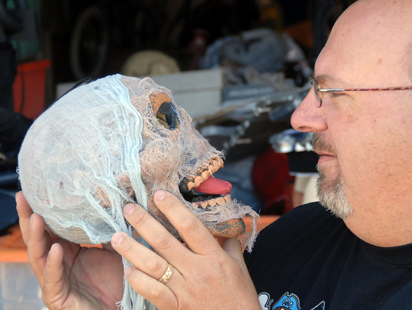 "Jim O'Dell looks at one of his favorite skulls, on Thursday, which he will use in his ""Chilling Hour"" haunted house at 920 Coral St. for Halloween.<br /> <br /> October 22, 2009<br /> Staff photo/David R. Jennings"