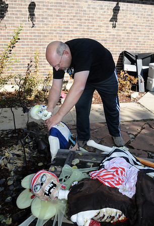 """Jim O'Dell arranges pirate skeletons for his """"Chilling Hour"""" haunted house at 920 Coral St. on Thursday for Halloween.<br /> <br /> October 22, 2009<br /> Staff photo/David R. Jennings"""