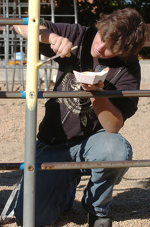 Roland Platt, 17, New Vista High, paints the playground equipment at Emerald Elementary School on Wednesday. <br /> October 16, 2011<br /> staff photo/ David R. Jennings
