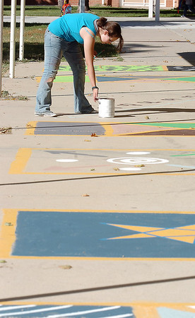 New Vista High student Lea Heinrich works on finishing different educational playground murals at Emerald Elementary School on Wednesday. <br /> October 16, 2011<br /> staff photo/ David R. Jennings