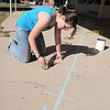 New Vista High student Lea Heinrich, 15, paints for a number line outside of classrooms at Emerald Elementary School on Wednesday. <br /> October 16, 2011<br /> staff photo/ David R. Jennings