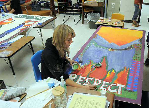 Emily Coffee, New Vista High, works on painting a mural she designed for Emerald Elementary School on Wednesday. <br /> October 16, 2011<br /> staff photo/ David R. Jennings