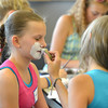 Jenna Ammidown, 11, right,  begins to paint a raccoon face on Meredith Frey, 12, during the Night Visitors Makeup Session by taught by Leah Reddell at the Mamie Doud Eisenhower Public Library on Friday. <br /> June22, 2012<br /> staff photo/ David R. Jennings