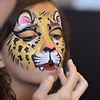Chole Green, 11, has her face painted as a leopard by artist Leah Reddell during the Night Visitors Makeup Session by Reddell at the Mamie Doud Eisenhower Public Library on Friday. More than 20 students attended the session.<br /> June22, 2012<br /> staff photo/ David R. Jennings