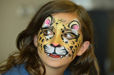 Chole Green, 11, models her leopard face painted by artist Leah Reddell during the Night Visitors Makeup Session by Reddell at the Mamie Doud Eisenhower Public Library on Friday. More than 20 students attended the session. June22, 2012 staff photo/ David R. Jennings  please see www.broomfieldenterprise.com for a gallery of photos and video
