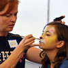 Artist Leah Reddell paints leopard face on Chole Green, 11, as a demonstration to the more than 20 students who attended the Night Visitors Makeup Session by Reddell at the Mamie Doud Eisenhower Public Library on Friday. All of the make up used was professional cosmetic and water based. <br /> June22, 2012<br /> staff photo/ David R. Jennings