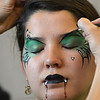 Artist Leah Reddell uses a brush to paint eyebrows for the vampire face on Camille Green, 14, as a demonstration to the more than 20 students who attended the Night Visitors Makeup Session by Reddell at the Mamie Doud Eisenhower Public Library on Friday. <br /> June22, 2012<br /> staff photo/ David R. Jennings