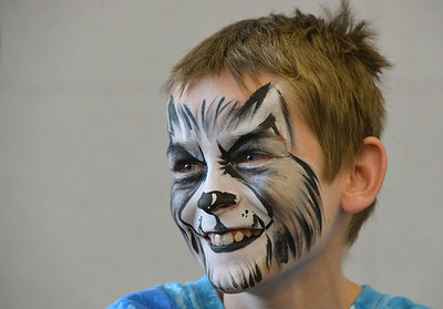 Noah Tibbetts, 10, smiles after having a wolf face painted on his face by artist Leah Reddell during the Night Visitors Makeup Session by Reddell at the Mamie Doud Eisenhower Public Library on Friday. All of the make up used was professional cosmetic and water based.  June22, 2012 staff photo/ David R. Jennings