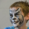 Noah Tibbetts, 10, smiles after having a wolf face painted on his face by artist Leah Reddell during the Night Visitors Makeup Session by Reddell at the Mamie Doud Eisenhower Public Library on Friday. All of the make up used was professional cosmetic and water based. <br /> June22, 2012<br /> staff photo/ David R. Jennings