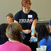 Leah Reddell shows students different techniques of using a sponge   during the Night Visitors Makeup Session by taught by Leah Reddell at the Mamie Doud Eisenhower Public Library on Friday. More than 20 students attended the session.<br /> June22, 2012<br /> staff photo/ David R. Jennings