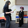 Stacy Young, left, with questions, tries to guess who is  Erin Hohnstein dressed as, first lady Eleanor Roosevelt,  during the Meridian Elementary School third grade Night of the Notables on Wednesday. Hohnstein is Eleanor Roosevelt.<br /> <br /> May 5, 2010<br /> Staff photo/ David R. Jennings