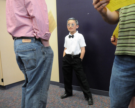 Bryce Mayemura answers questions from parents as artist Marc Brown, creator of Arthur, during the Meridian Elementary School third grade Night of the Notables on Wednesday.<br /> <br /> May 5, 2010<br /> Staff photo/ David R. Jennings