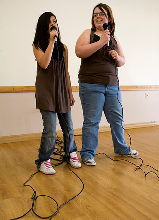 Natali Cadena, left age 10 and Brianna Whitbred, sing during their audition for theseventh annual Night of the Stars Talent Competition on Saturday at theBroomfieldCommunity Center.<br /> <br /> photo/Matt Kelley