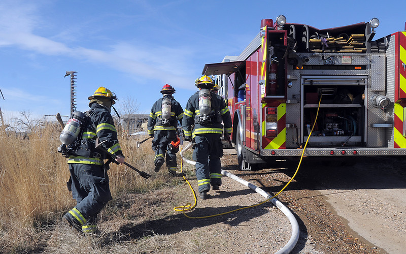 "North Metro Fire Rescue firefighters walk to fight a house fire on Weld County Rd. 11 north of Weld County Rd. 4 in Broomfield on Thursday. The resident of the home was not injured. <br /> For more photos please see  <a href=""http://www.broomfieldenterprise.com"">http://www.broomfieldenterprise.com</a><br /> January 23, 2012<br /> staff photo/ David R. Jennings"