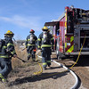 """North Metro Fire Rescue firefighters walk to fight a house fire on Weld County Rd. 11 north of Weld County Rd. 4 in Broomfield on Thursday. The resident of the home was not injured. <br /> For more photos please see  <a href=""""http://www.broomfieldenterprise.com"""">http://www.broomfieldenterprise.com</a><br /> January 23, 2012<br /> staff photo/ David R. Jennings"""