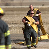 """North Metro Fire Rescue firefighters pick up hoses after fighting a house fire on Weld County Rd. 11 north of Weld County Rd. 4 in Broomfield on Thursday. The resident of the home was not injured. <br /> For more photos please see  <a href=""""http://www.broomfieldenterprise.com"""">http://www.broomfieldenterprise.com</a><br /> January 23, 2012<br /> staff photo/ David R. Jennings"""